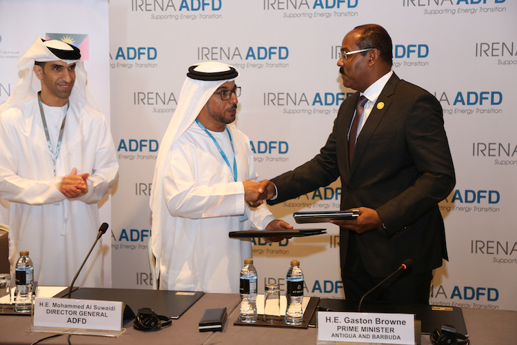 Photo: Antigua and Barbuda Prime Minister Gaston Browne (right) shakes hand with ADFD Director General Mohammed Saif Al Suwaidi while Thani Al Zeyoudi, Minister of Climate Change and Environment in the United Arab Emirates, looks on. Credit: Desmond L. Brown | IDN-INPS