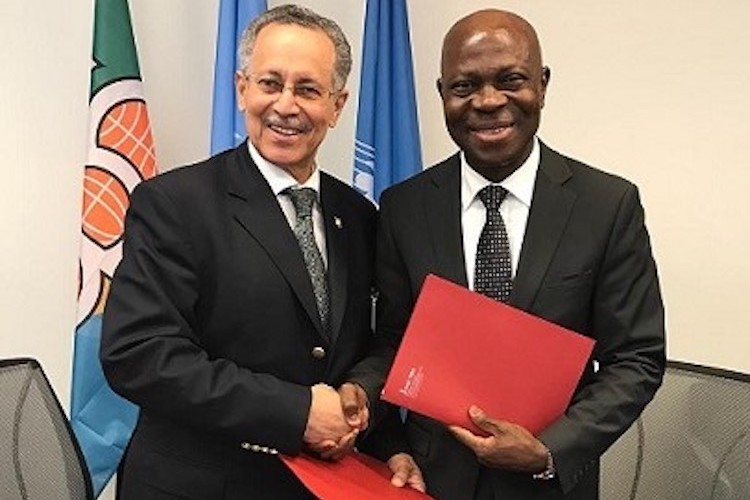 Photo (left to right): ACP Group Secretary-General Dr Gomes and IFAD President Houngbo exchange letters of intent to strengthen cooperation. Credit: ACP